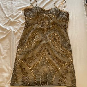Dresses & Skirts - A pre-owned beaded gown
